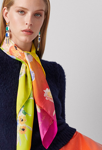 Woman wearing vibrant floral-print neck scarf