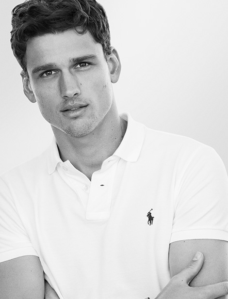 Man in white Polo shirt with Polo Pony at chest