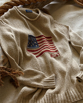 Cream rollneck sweater with American flag motif at chest