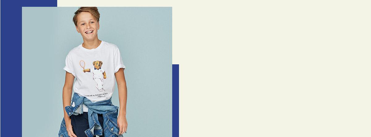 Boy wears tennis Polo Bear tea with jean jacket around waist.