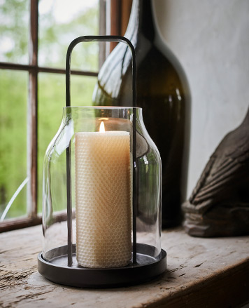 Glass hurricane with metal base & handles & honeycomb-embossed candle