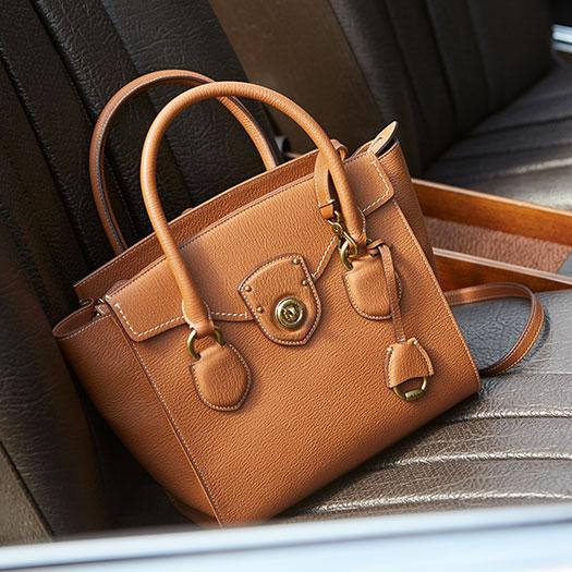 Large tan handbag with flapped pocket at front