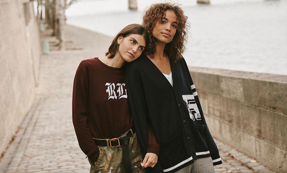 Two women in custom sweaters