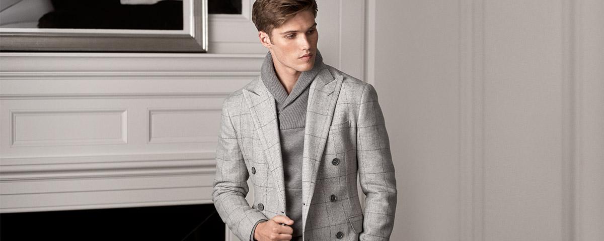 Model in dark grey shawl sweater & light grey windowpane sport coat