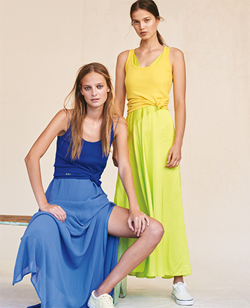 Women in blue and yellow-green maxidresses