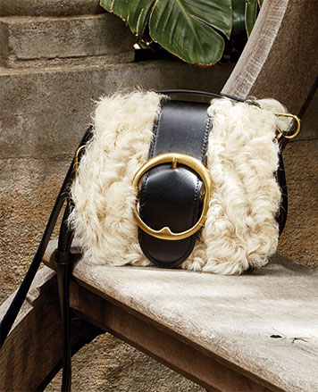 Long-haired lamb shearling shoulder bag with large buckle at front