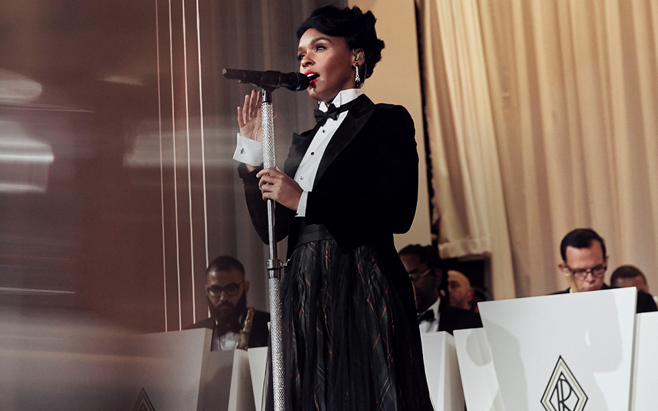 Janelle Monáe singing in tuxedo-inspired look at the Fall 2019 Runway Show