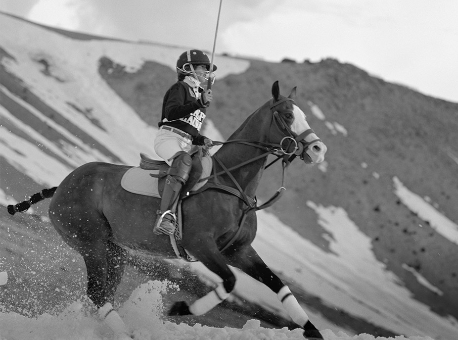 Polo player on horseback in snow