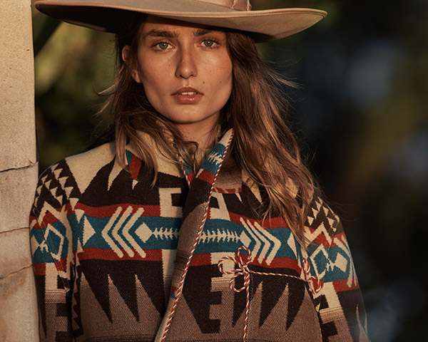 Woman in Southwestern-inspired coat and brimmed hat