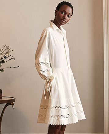Woman in lace-trimmed long-sleeve white fit-and-flare dress