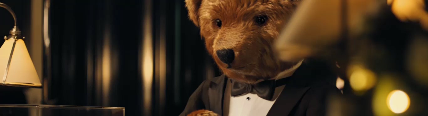 Video of Polo Bear in tux placing presents under tree