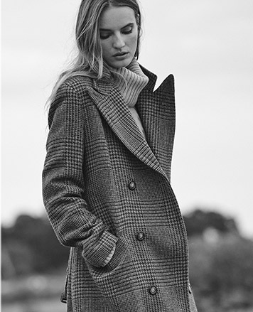 Woman in wool houndstooth coat