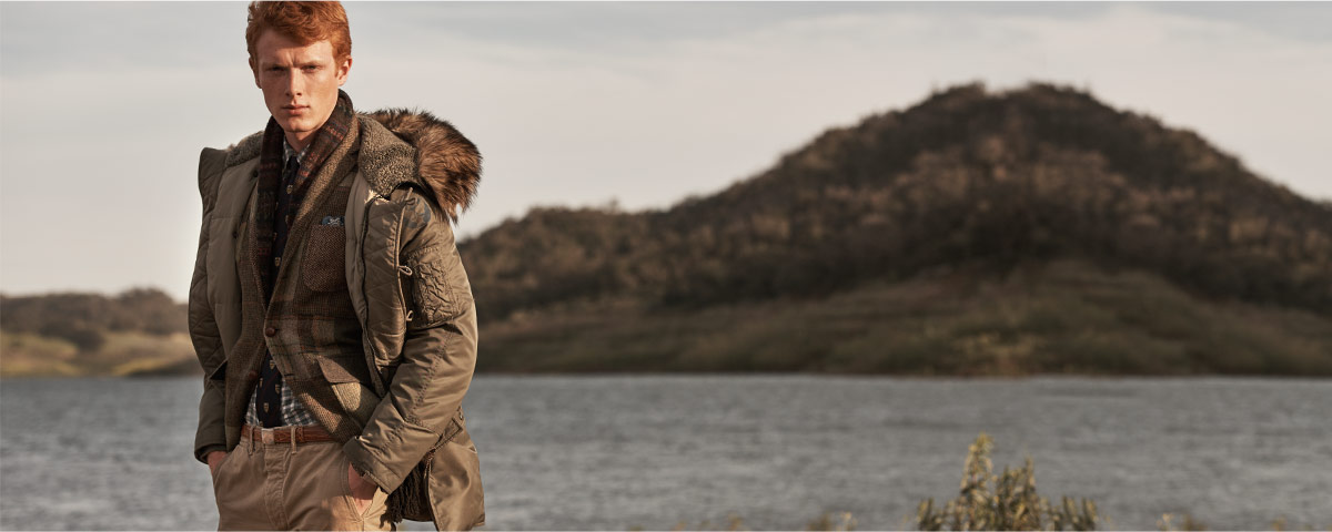 Model in olive parka with faux-fur trim at the hood