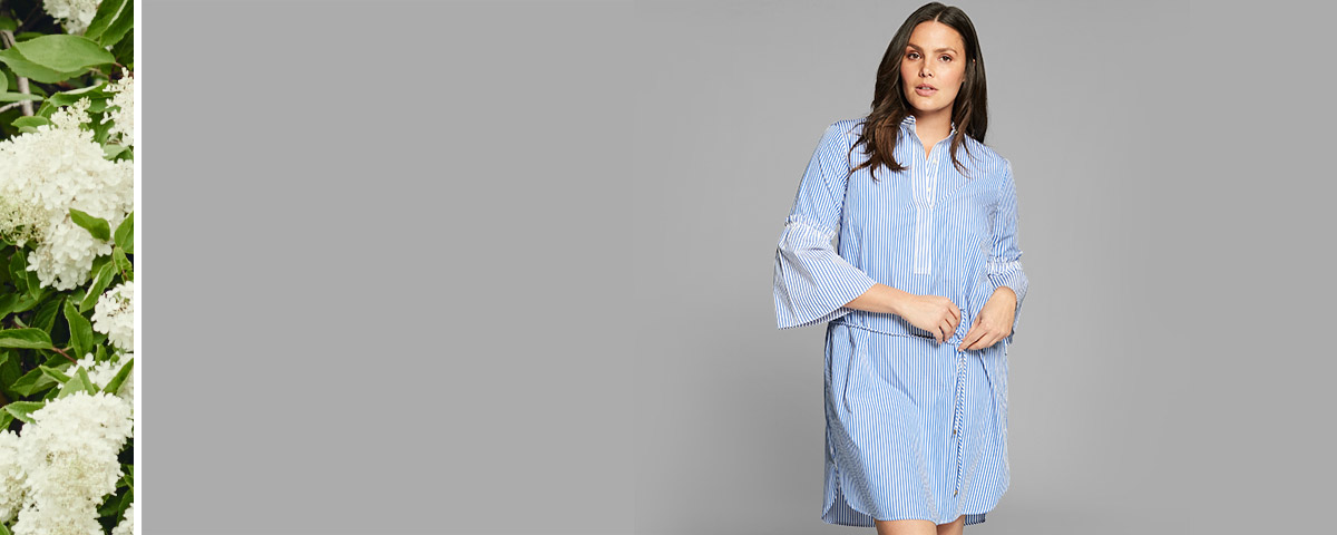 Model in blue-and-white striped bell-sleeve shirtdress