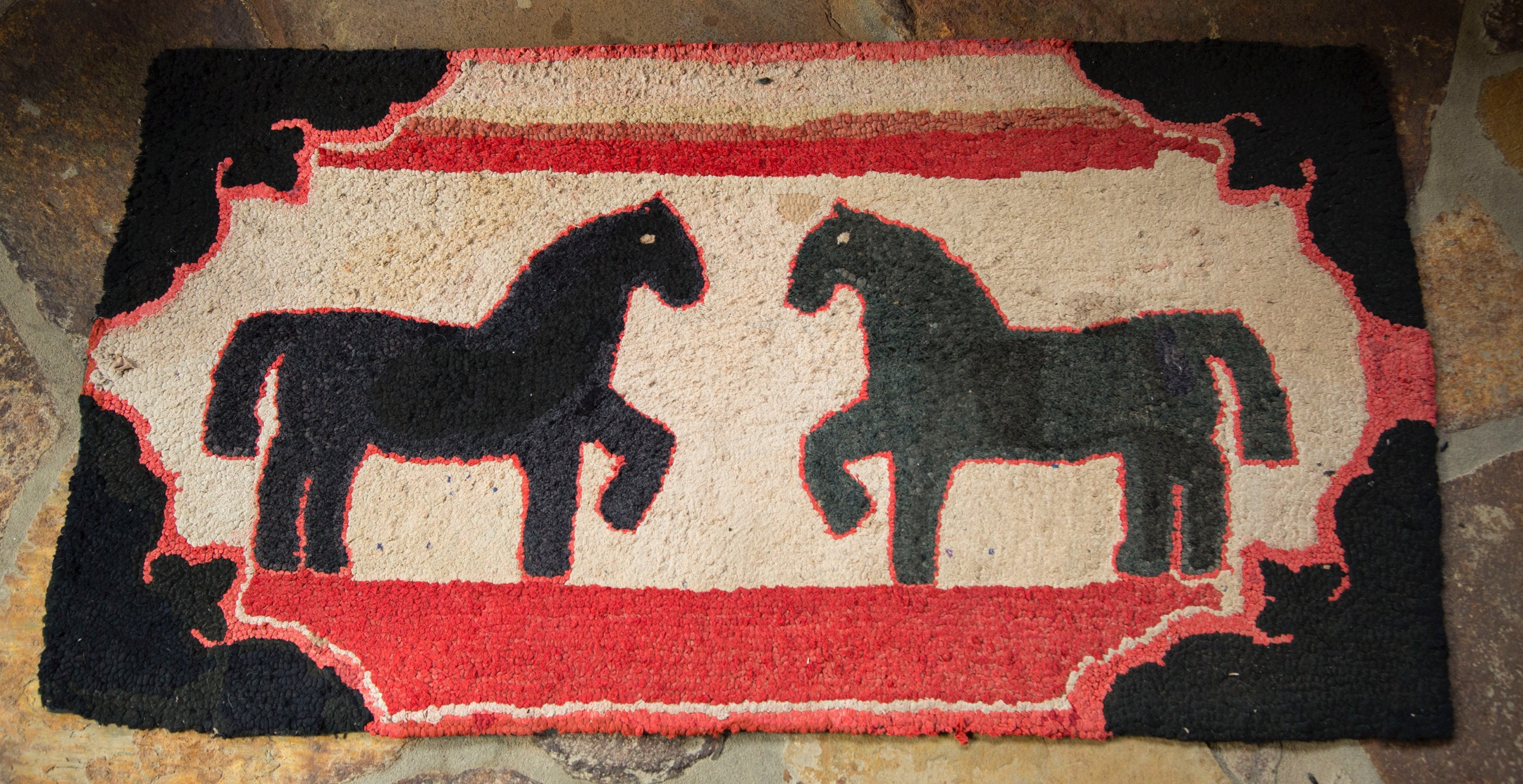 Early rag rugs like this one of a horse-to-horse greeting are better preserved as wall hangings rather than displayed underfoot
