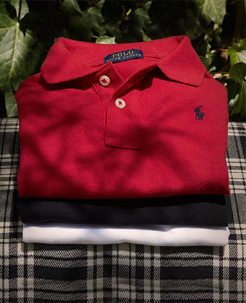 Stack of red, black, and white Polo shirts.