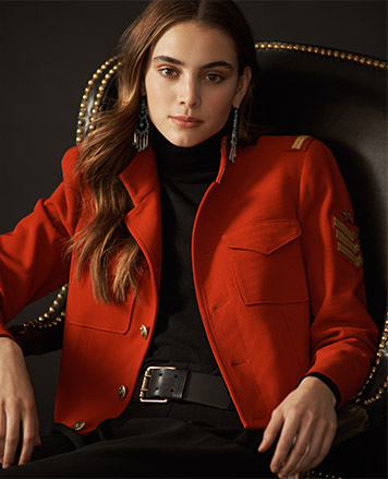 Woman in military-inspired cropped red jacket