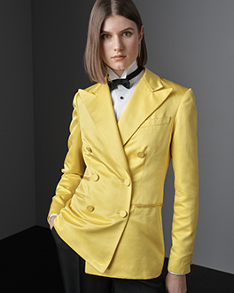 Woman in yellow blazer & bow tie