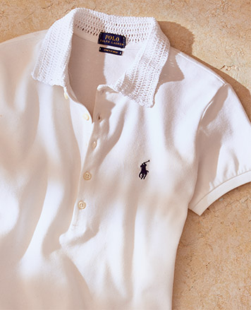 White Polo shirt with navy signature embroidered pony at chest