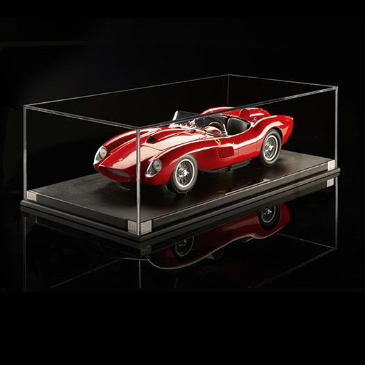 Miniature model of vintage red race car