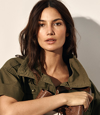 Woman in short-sleeve army green jacket