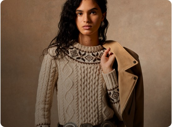 Woman in neutral-hued Fair Isle Aran-knit sweater.