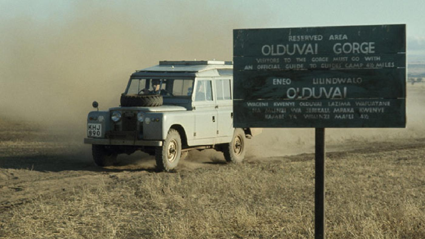 A Defender stirs up dust as it's driven near the Olduvai Gorge, in Tanzania