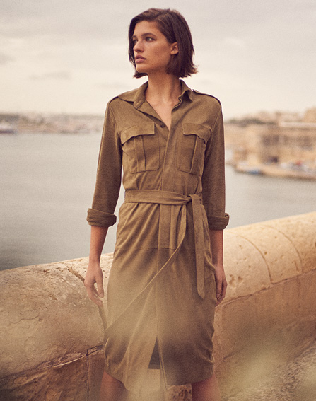 Woman in olive wrap dress