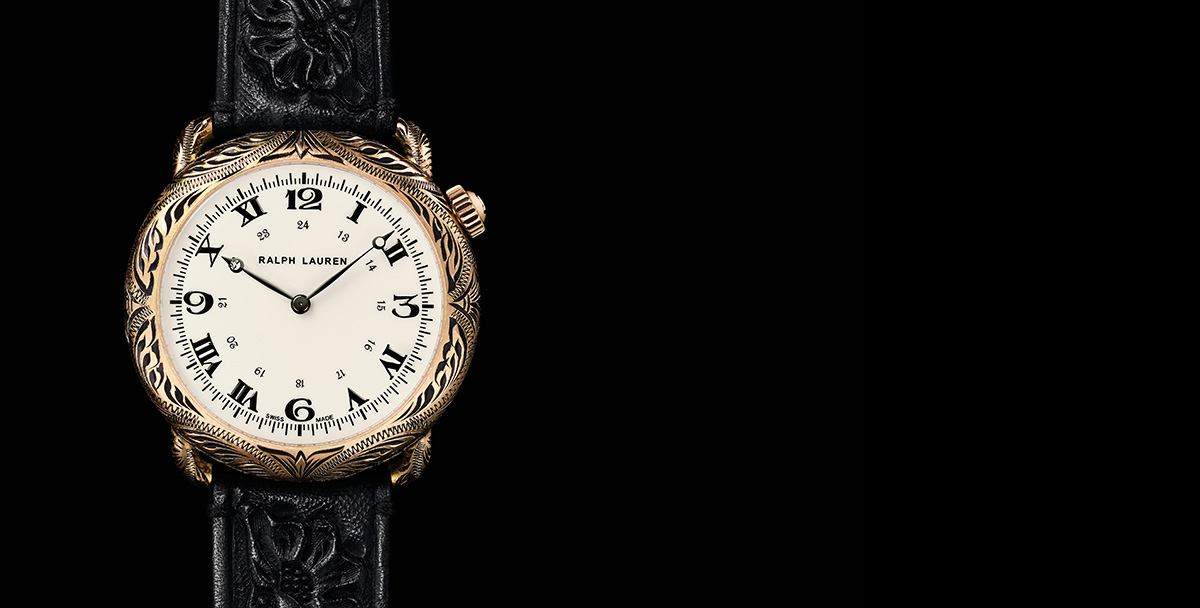 Rounded watch with intricate engraving & hand-tooled black leather strap