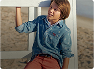 Boy in denim shirt with allover star pattern.