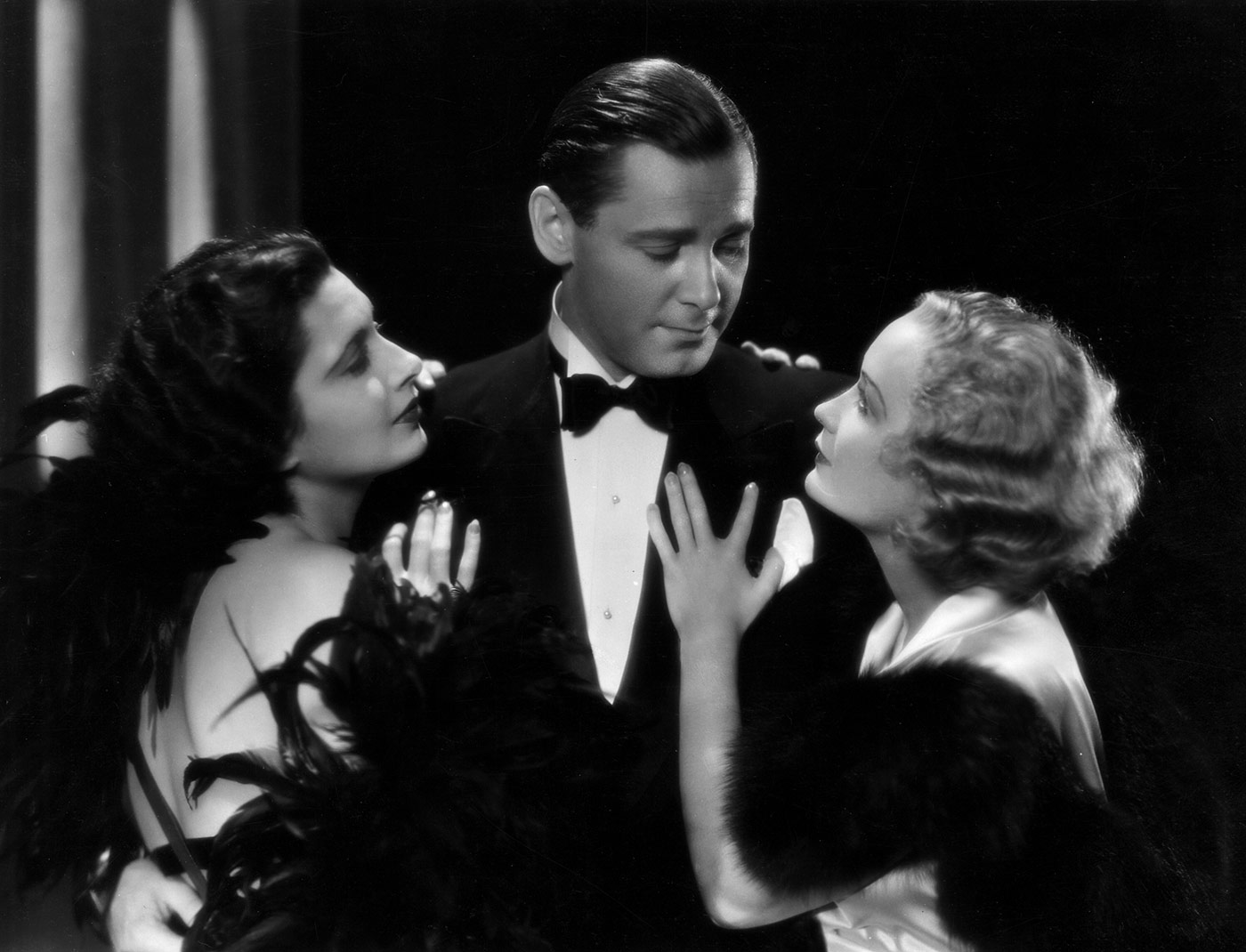 (Left to right) Kay Francis, Herbert Marshall, and Miriam Hopkins starred in the 1932 Ernst Lubitsch classic <em>Trouble&nbsp;in&nbsp;Paradise</em>