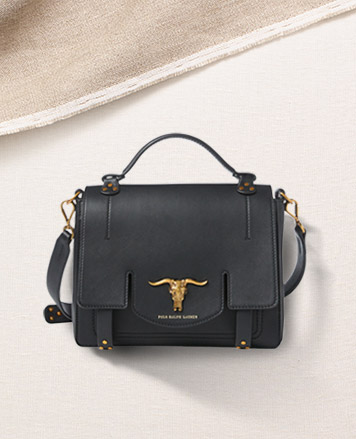 Black leather bag with steer-head accent at front