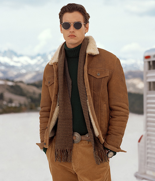 Man in shearling-lined tan suede jacket