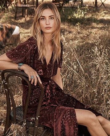 Model in maroon textured velvet dress