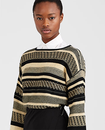 Model in linen sweater with textural black & tan stripes