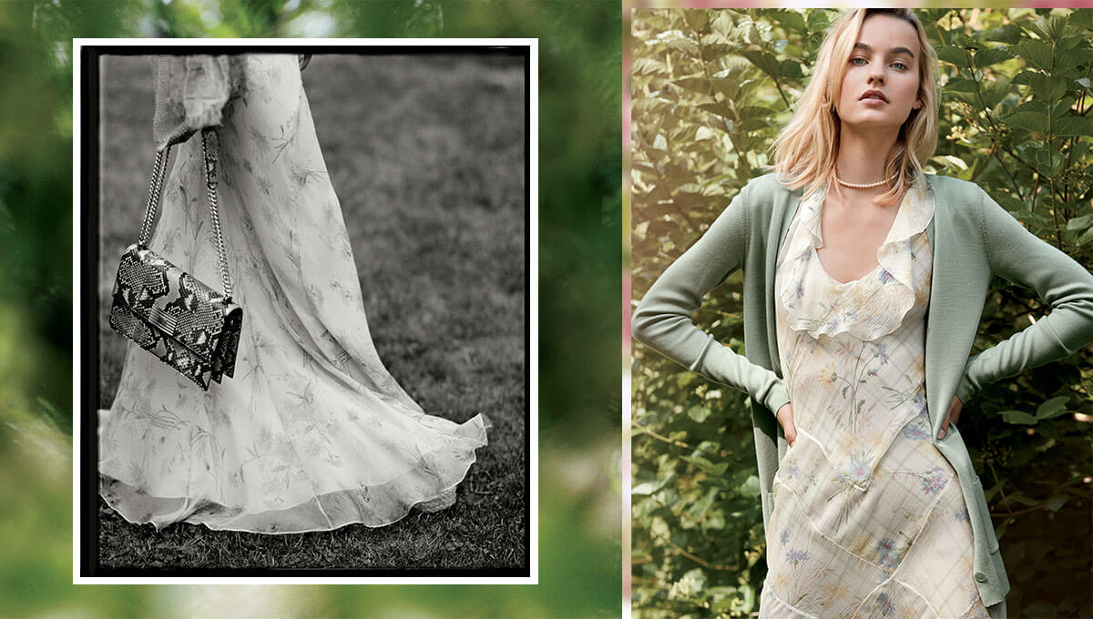Greyscale image of woman from waist down in sheer floral dress - Woman in sage cardigan over sheer floral dress