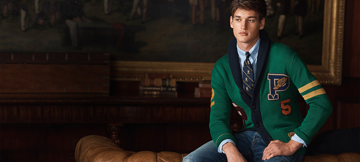 Man in Irish green cardigan with navy trim & contrast stripes