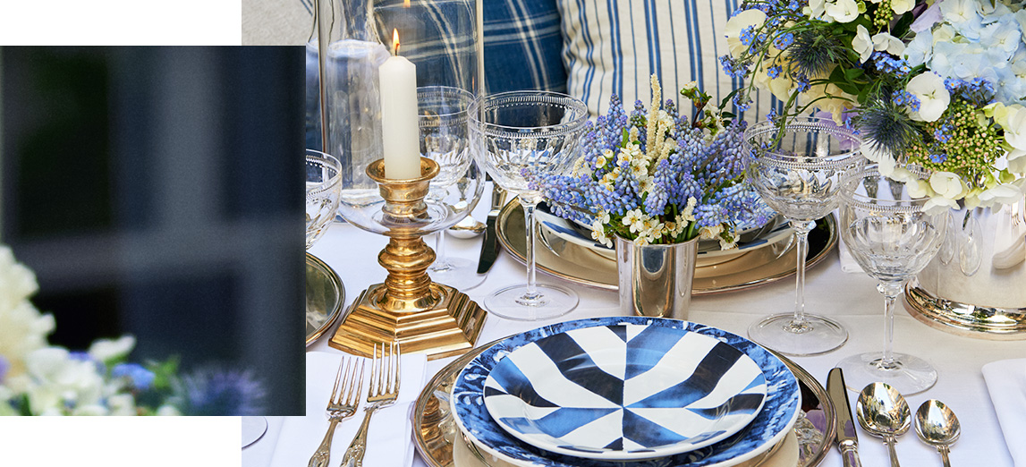 Table set with stoneware plates with blue painterly stripes
