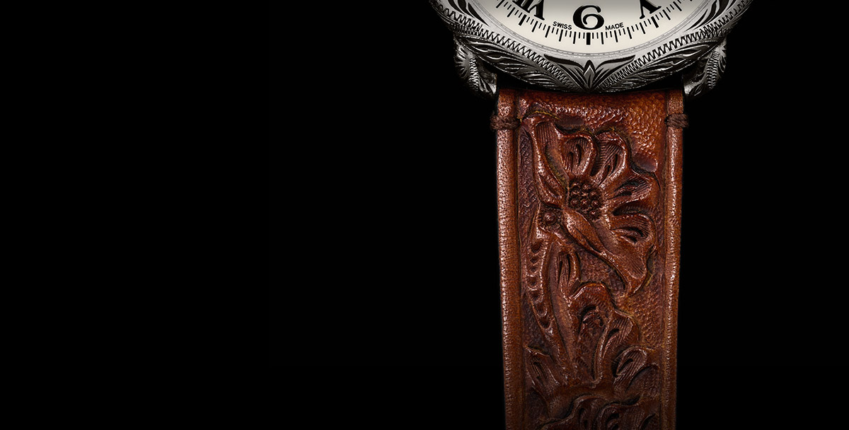 Hand-tooled leather strap with floral motif