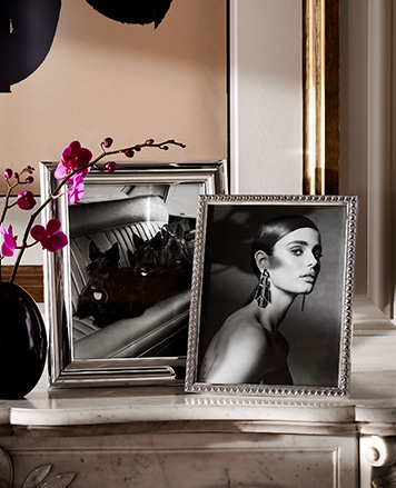 Silver picture frames on marble counter