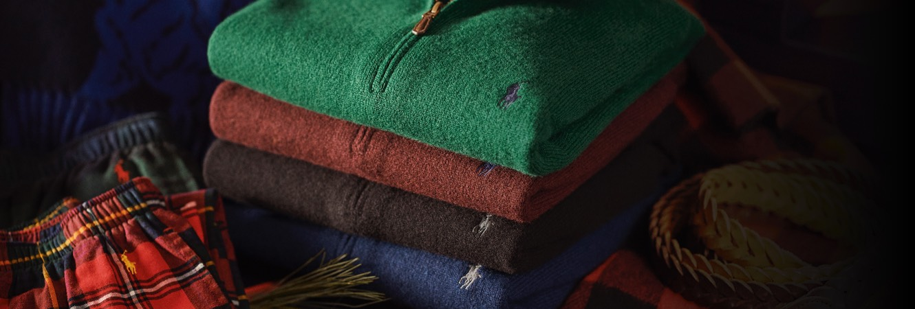 Stack of folded quarter-zips in different hues with Polo Pony accent
