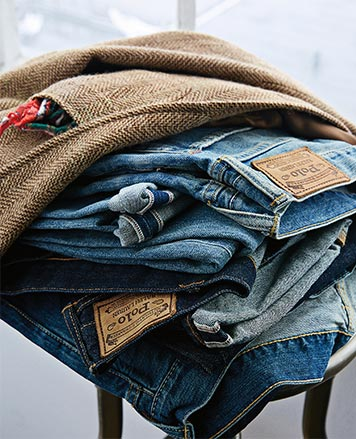 Stack of Polo jeans in varying washes