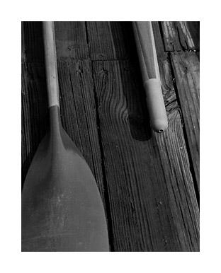 Photograph of rowing oars on wood floor