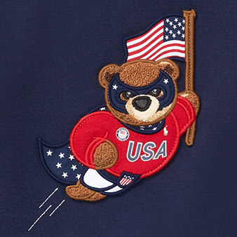 Close-up of graphic of Polo Bear wearing patriotic superhero uniform