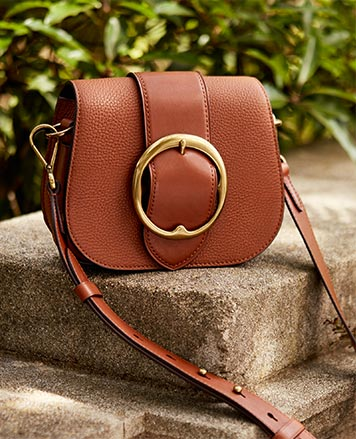 Pebbled brown leather bag with large antiqued buckle at front