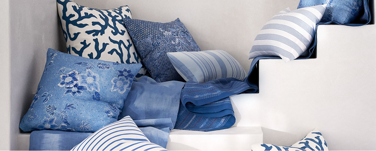 Throw pillows with shams in various shades of blue & prints
