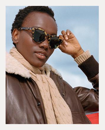 Woman wears tortoiseshell round sunglasses