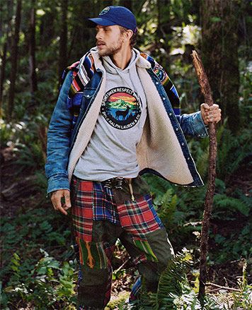 Man in patchwork plaid pants & wildlife graphic tee