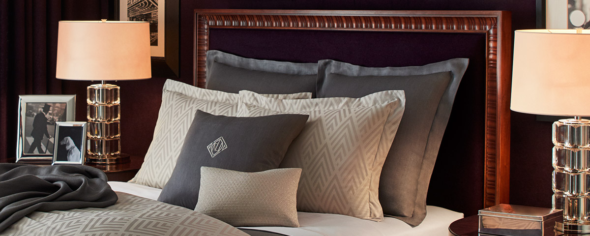 Bed with chevron-stripe & grey sheeting