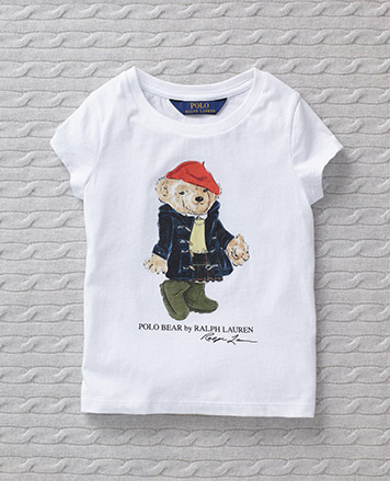 T-shirt with Polo Bear wearing a raincoat, rain boots, and a rain hat.
